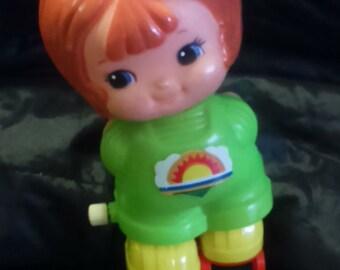 Vintage 1979 TOMY Girl Roller Skating WIND UP Toy