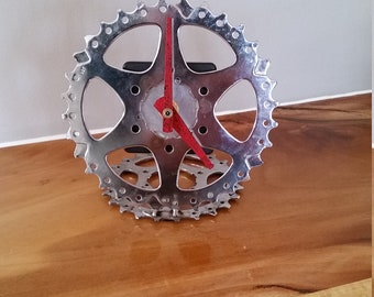 recycled bike gear clock, unpainted with natural finish and red hands
