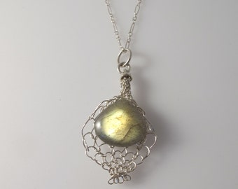 Labradirite floating pendant on an 18 inch sterling chain.