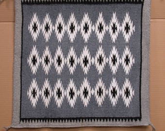 AMERICAN SOUTH-WEST, Navajo Nation. Original Childs Weaving Competition, Wool Rug. 20 1/2 x 20 inches.