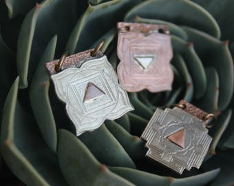 Copper and silver accented Yantra Pendants