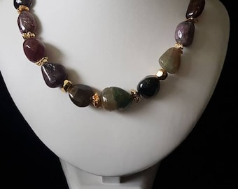 Tourmaline with gold plated hematite nuggets with a gold plated clasp.