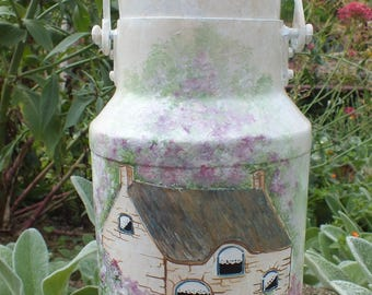 Vintage: retro object painted - on an old milk can a pretty cottage in the blue door