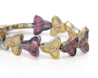 A set of 10 glass purple and yellow gold Celtic knot beads.