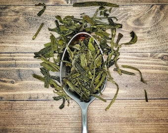 Dragonwell Tea - traditional green tea is a favored tea in the East and is described as the tea of Emperors