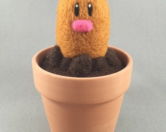 "Diglett. Needle Felted. 100% handmade Pokemon character. Measures: 2.75"" wide at base x 3"" high."