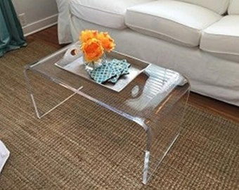 "Acrylic coffee table 36"" x 18"" x 18"" made of .750"" thick material"