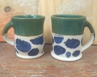 A Couple of Handmade Pottery Mugs in Metallic Green with Mocha Diffusion 12 oz