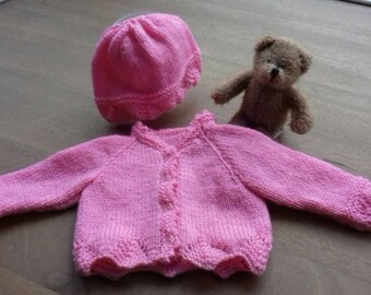 Pink cardigan with matching hat