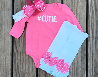 Bodysuit #CUTIE, ruffled leg warmer set, and headband with bow