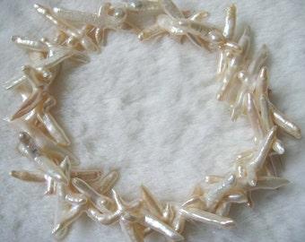 Full Strand Large White Biwa Cross Freshwater Pearls