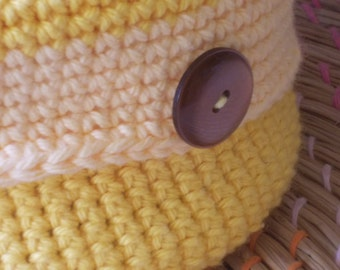 Yellow crocheted bowl( reversible)with light yellow trim and 4 vintage buttons.