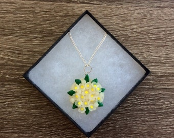 Polymer clay necklace with white flowers