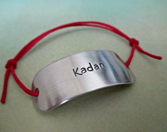 kadan - hand stamped dragon age the iron bull inspired aluminum adjustable cord bracelet