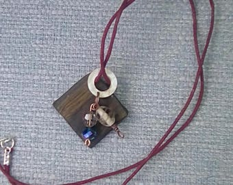 Necklace ebony wood pendant with mother of pearl and glass beads