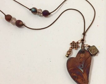 Ceramic heart with accent charms on cord