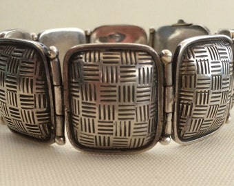 1940's basket weave puffy link bracelet with hidden clasp. May be Navajo. Estate bracelet.
