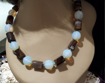 One strand beaded faceted opalite and onyx necklace