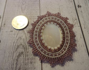 Vintage glass Beaded Brooch w/ Mother of Pearl Center, White and Mauve Beads on Leather Backing