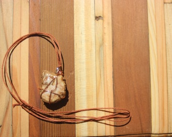 Copper wrapped granite rock necklace
