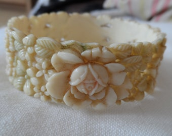 1930's wide celluloid bangle with roses ,hellebores etc