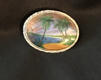 Antique silver brooch with hand painted scene