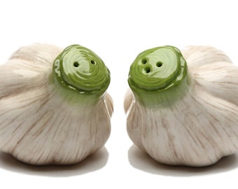 "Pair of garlic bulbs Salt and Pepper Shaker 3.25"" long 2.5"" tall"