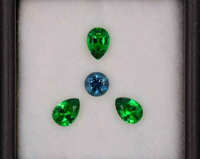 Spectacular Green Tsavorite Garnet and Blue Montana Sapphire Set, 1.89 tcw., Pear and Round Shape.