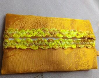 Mustard and yellow tissue holder