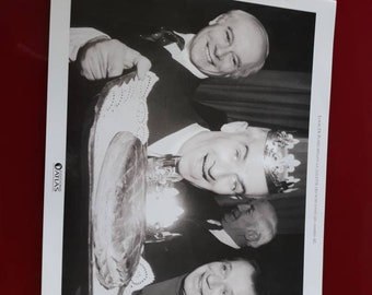 A black and white photo of Louis funes pulling Kings in the 1960s