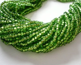 Vintage Lime Green Silver Lined Glass Seed Beads  Hank of 11 Strands