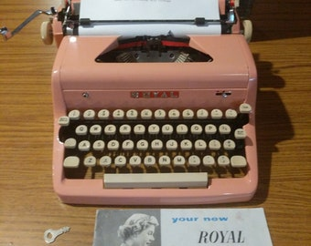 1955 bubble gum pink  Royal Quiet Deluxe portable typewriter with case, manual, and key to lock the case