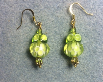 Lime green lampwork owl bead dangle earrings adorned with lime green Czech glass beads.