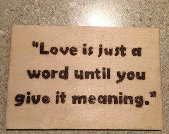 Love is just a word woodburned quote