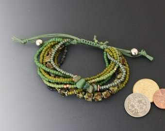 Multi-strand bracelet with macrame sliding knot. One size fits most. Turquoise, copper, and sterling jewelry.
