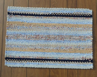 Rectangular striped twined rag rug cream, white, tan, blues