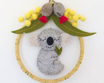 Koala baby mobile featuring Australian eucalyptus blossoms, gunleaves and wattle blossoms.