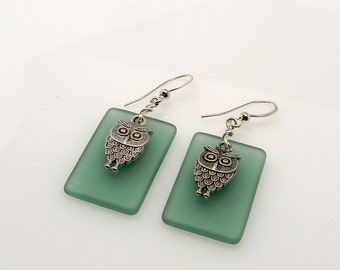 Beach glass jewelry earrings with owl charms.