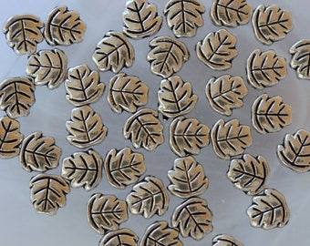 silver leaf shaped set of 5 beads