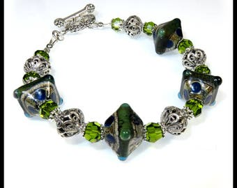 Green and blue lampwork glass with bali silver and olivine crystals, lampwork glass beads, lampwork glass bracelet,