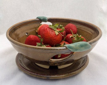 Pottery berry bowl/ colander, with cut-out leaf handles, leaf appliqués, and drip plate, brown and matte green glaze- ceramic berry bowl