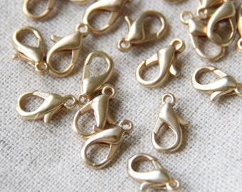 24pcs of brass lobster 12m--8600-matte gold/matte silver