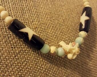 Snake vertebrae necklace with bone, ocean jasper, basalt, and Czech glass beads