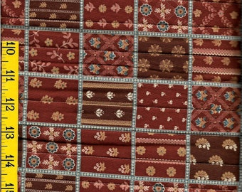 100 % cotton double faced quilted fabric, brown with tan and blue, sewing, crafting. Matches fabric listed