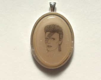 David Bowie portrait resin pendant silver plated bezel glow-in-the-dark