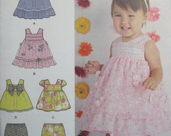 Simplicity 1471 - Babies dress, top and bloomers, sizes XXS (Newborn) to Large (21-24 lbs). View B has contrast overskirt. New, uncut.