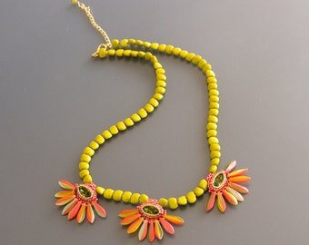 Necklace with Swarovski Crystal Oval Stones in Peridot Green and Petals in Bright Tangerine Orange and Light Green. Flower Pendants. S103