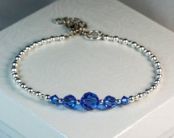 "Cynthia Lynn ""CELEBRATE"" Sapphire Blue Swarovski Crystal Silver September Birthstone Bangle Bracelet with Clasp"