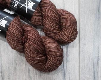 DK weight merino yarn 100% Superwash Merino Sweater weight yarn. Double Knit Weight yarn. Golgothan. Semi-Solid brown yarn. Tonal brown yarn