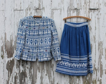1980s skirt and jacket set, blue and white cotton, woven geometric pattern of swans on skirt and deer on jacket, multicolor detail, medium